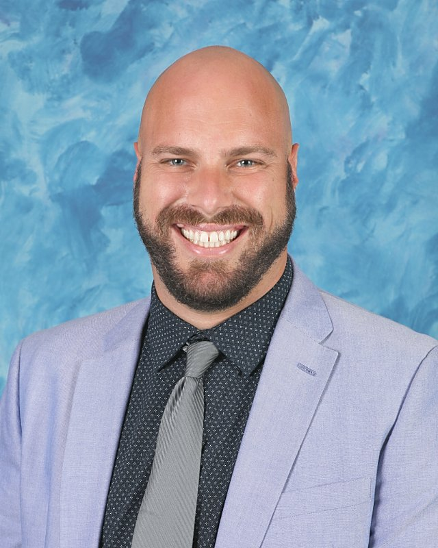 Mr. John Amann : Principal